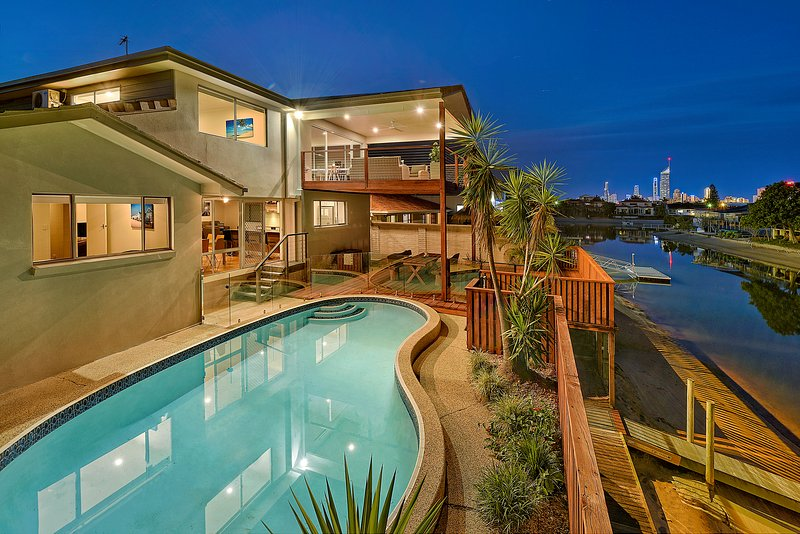 View at dusk with decking areas and private pool