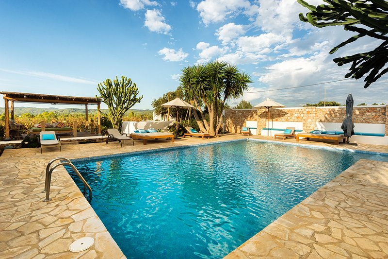 Inviting pool area with sunbeds and sunshades