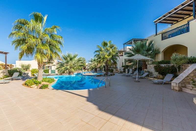 The pool area is equipped with sun beds, umbrellas and an outdoor shower!
