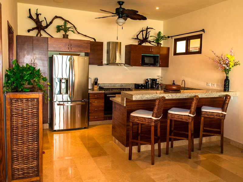 Gourmet kitchen with 6-burner stove, 2nd veggie sink, oversized french door fridge, and bar seating