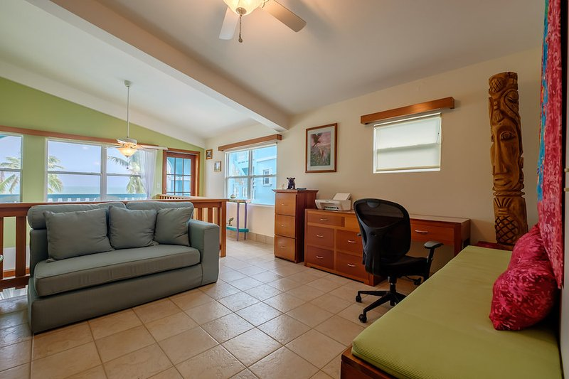 Loft office leads to upper level balcony/veranda