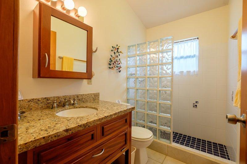 Upper level full bath with glass tiled shower & granite counter