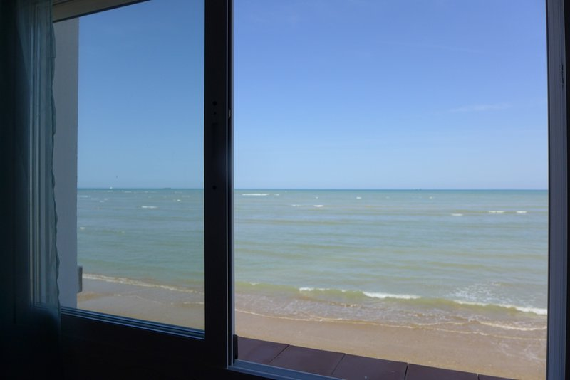 View from the window of the apartment Sol directly on the sea.