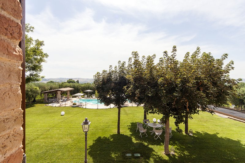 View the large garden with its fruit trees and olive trees that shade your relaxation area.