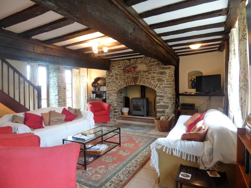 The spacious sitting room, with log burning stove