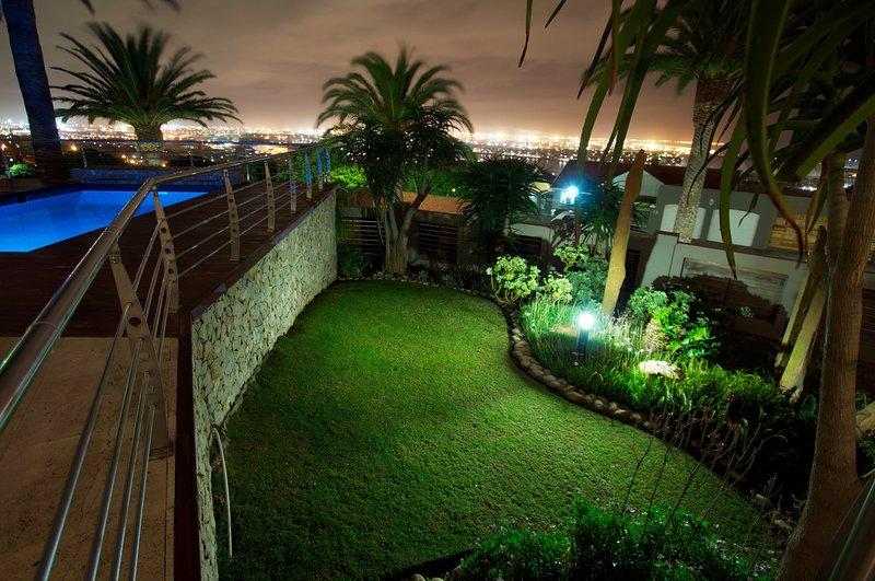 Jardin avec vue sur la nuit
