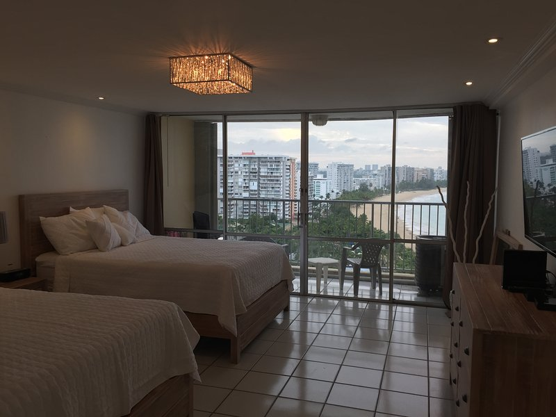 Newly renovated bedroom with unobstructed ocean & beach view.