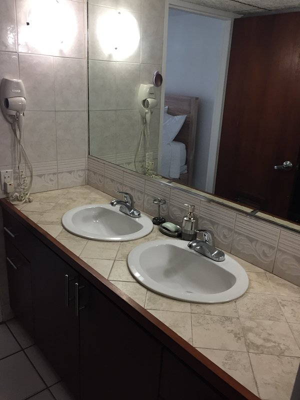Double sinks w plenty of counter space as well as 6 drawers and large underspace