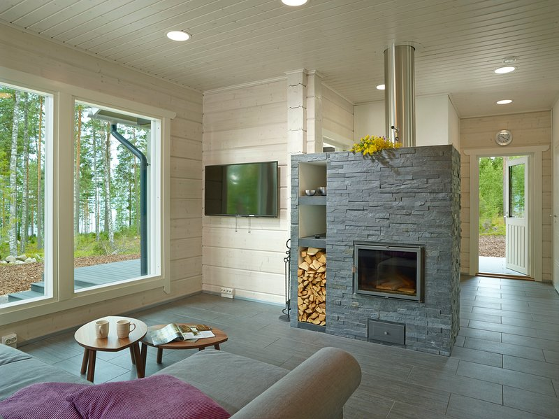 Living room and fireplace, nature friendly earth heating warms the store floors