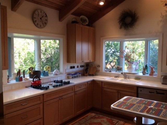 Large kitchen with dual since, high ceilings and gas range.