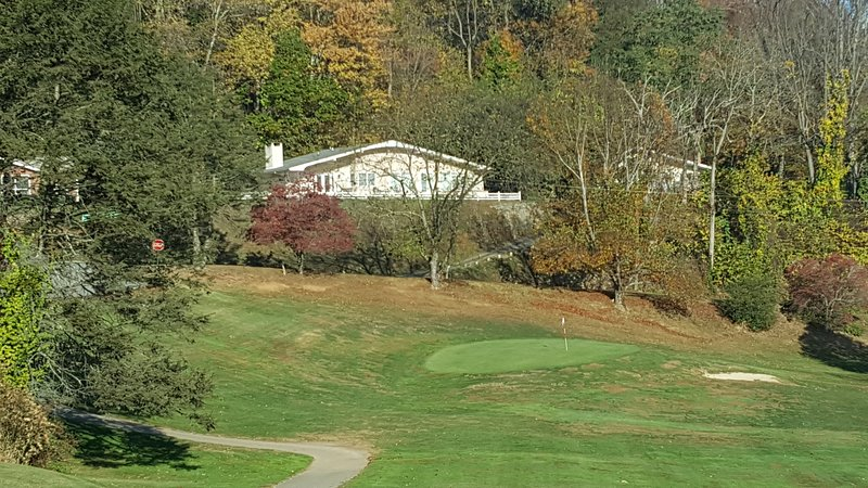 Home sits up looking over 9th hole, Lake Junaluska and Smoky Mountains