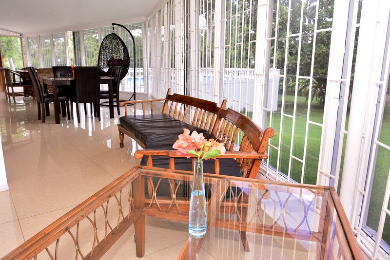 Part 2 of the of extra long dinning and computer area overlooks the pool also landscaped gardens