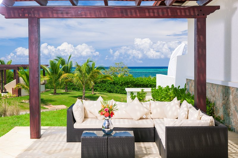 The patio for Pristine Bay 104 has views of the ocean