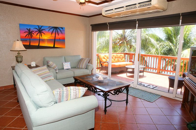 The living room is just off the kitchen and faces the sea
