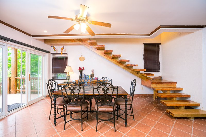 The dining area and stairs leading to the master bedroom on the second floor