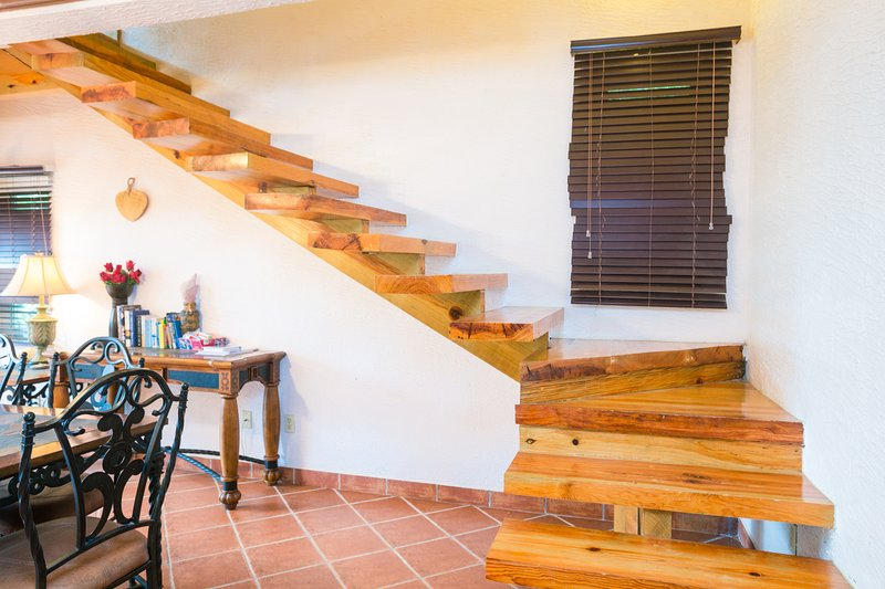 floating stair case to master suite.