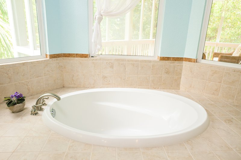 The tub in the master bathroom