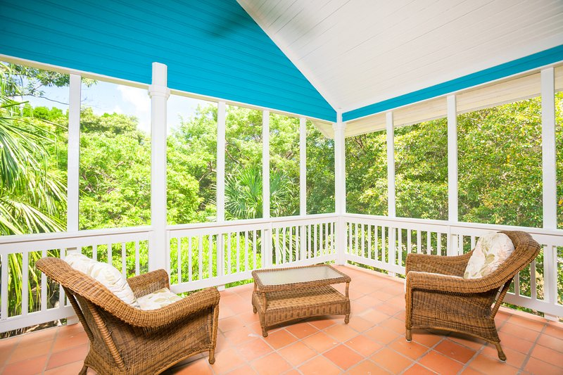 The private screened-in porch off the master bedroom