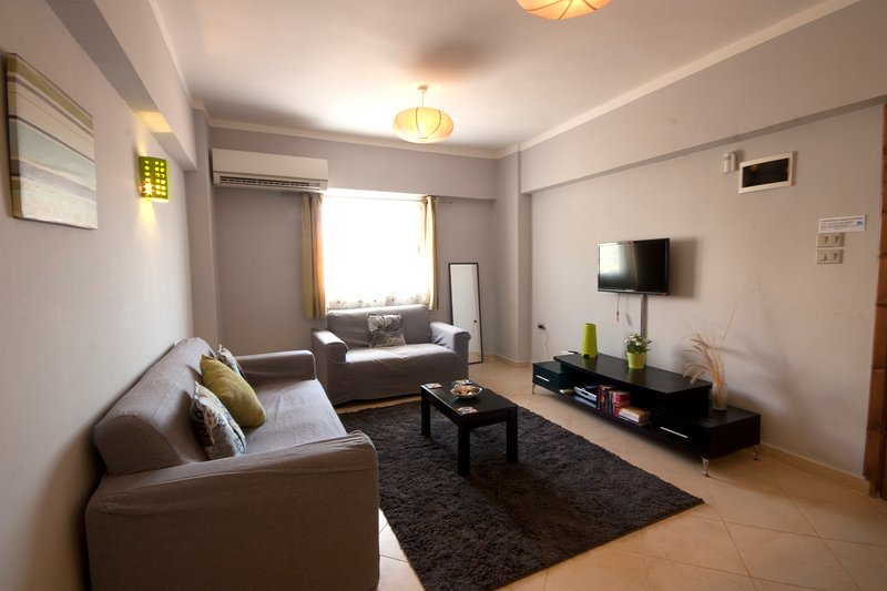 The living room has a stylish and comfortable sofa, quiet air conditioning, Satellite TV and wifi.