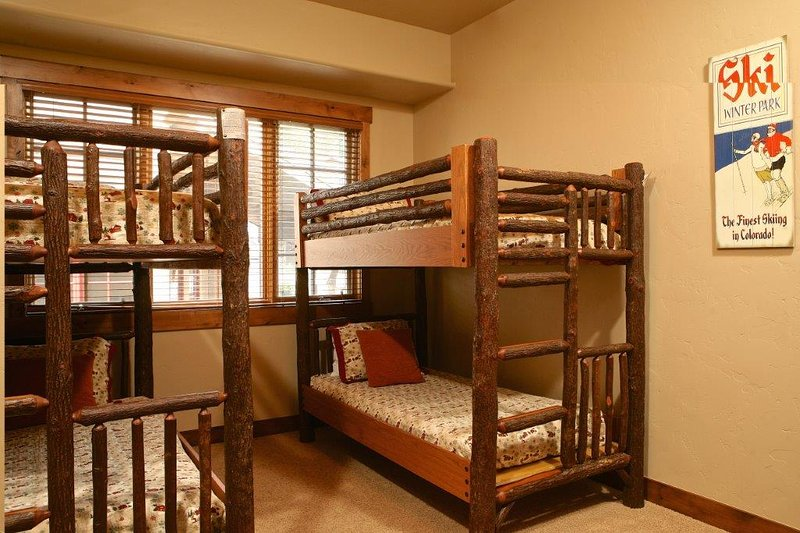 Third bedroom with two sets of twin bunks located on upper level.