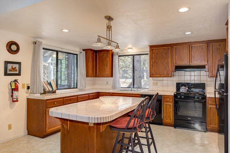 Very spacious Kitchen with Tile Counter Tops, New Appliances, Island with additional seating for 2