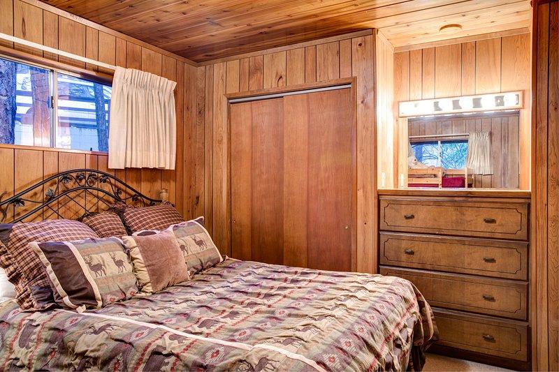 Bedroom 2 with queen bed, dresser and closet