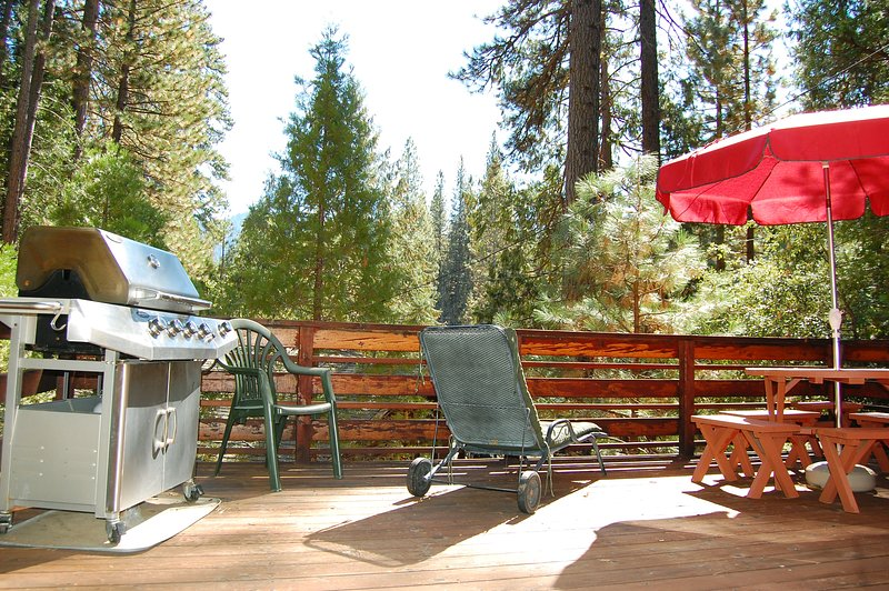 Back deck with gas grill, partial view of Merced River