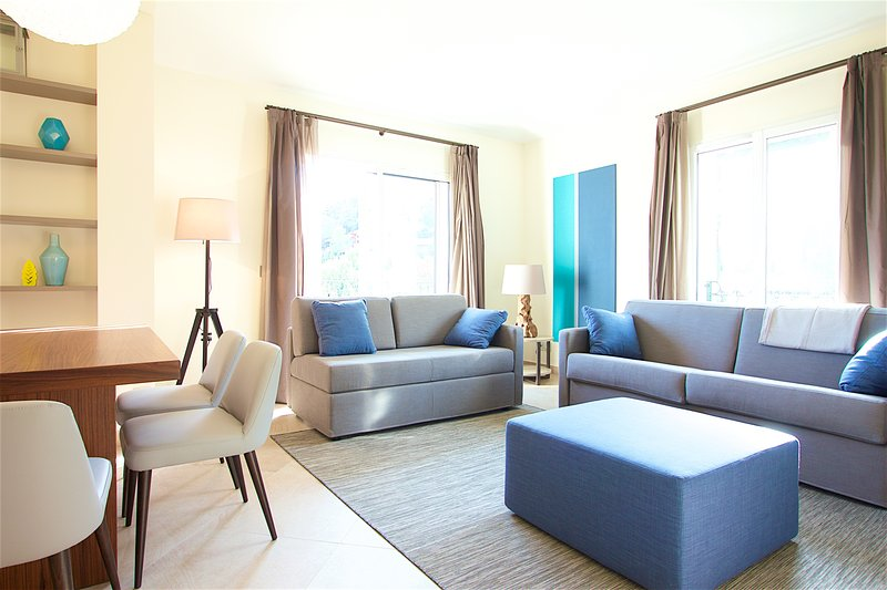 Beautiful living room with comfortable sofa bed,, access to a nice balcony,