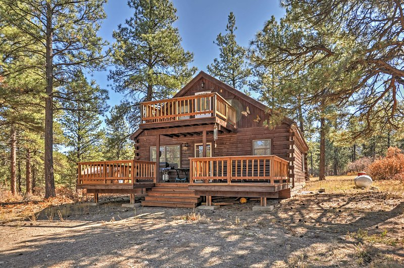 Tucked away on a secluded property surrounded by towering trees, this cabin promises a revitalizing retreat!
