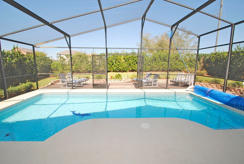 Very private, screened in pool with solar cover and large sun deck