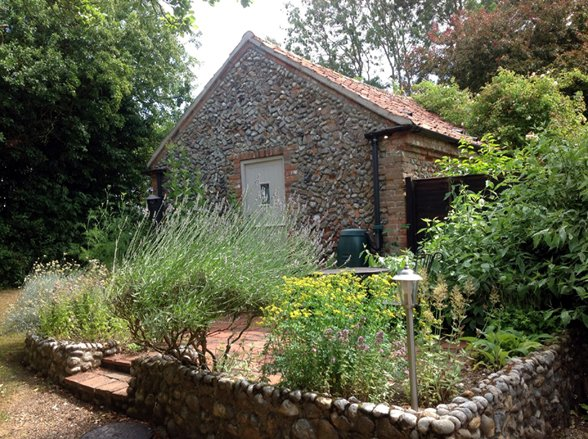 A charming detached cart barn conversion hidden away just five miles from the  North Norfolk coast.
