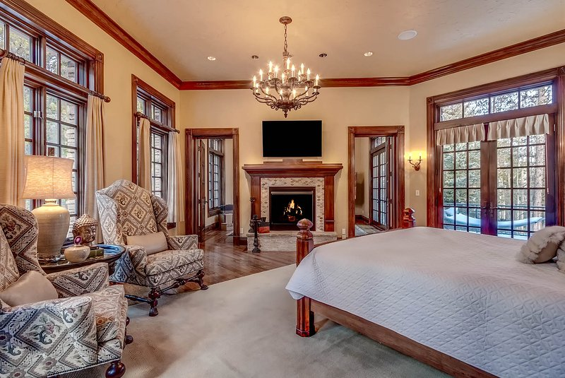 Master Suite with fireplace, private sitting room and private patio