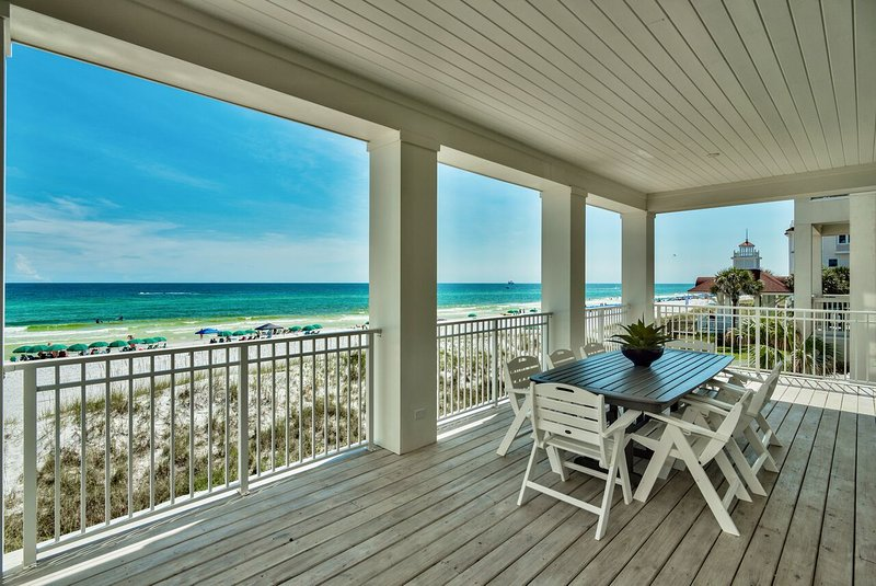 Beach front second floor balcony with dining table