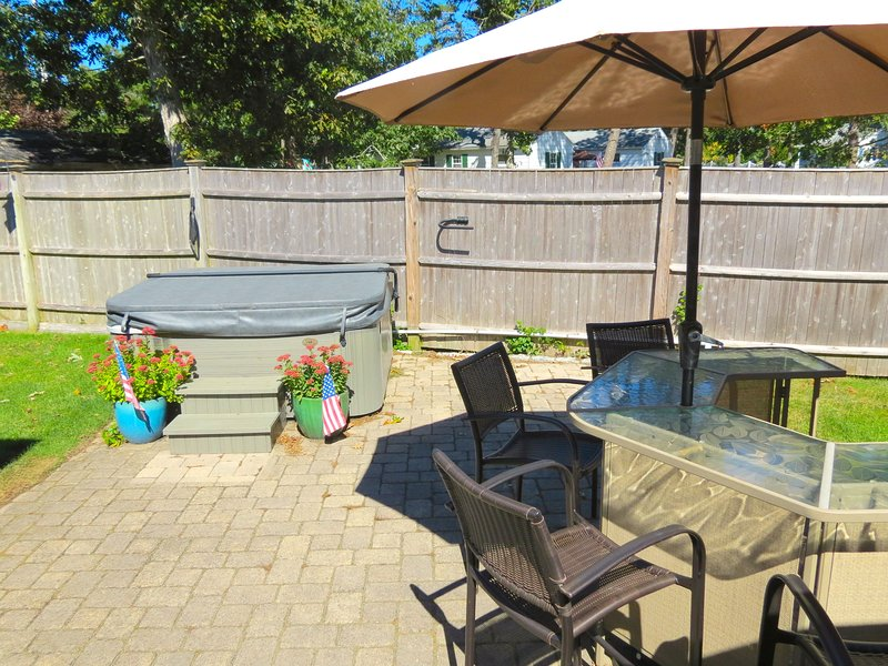 Enjoy outdoor living at its best with a spa tub, umbrella bar, gas grill and enclosed outdoor shower.