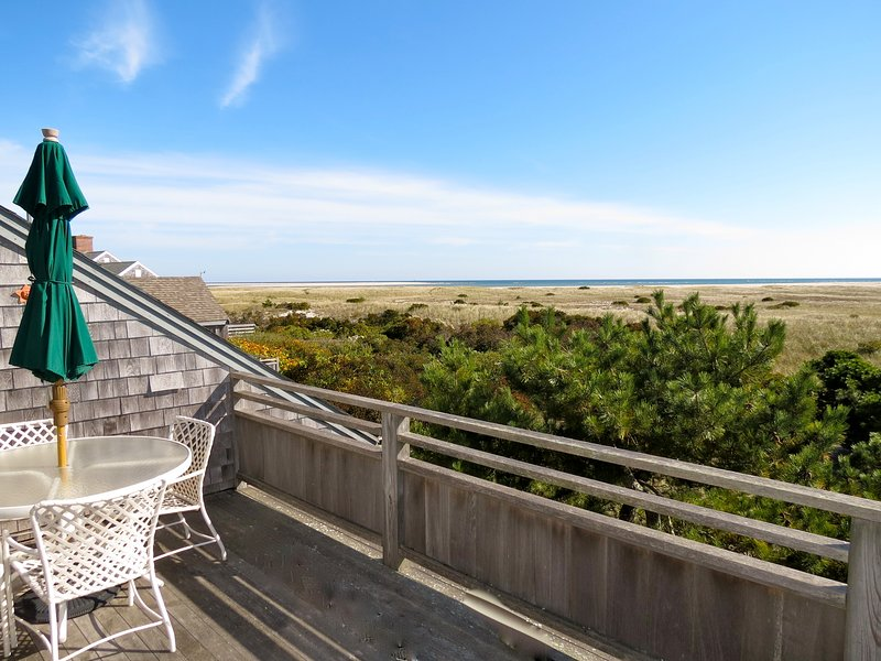 Expansive views of the Atlantic from this ideally situated Chatham home. That's the southern end of Chatham's Lighthouse Beach right out there. It's about an eight-minute walk to the beach.