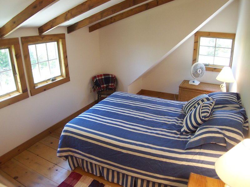 Upstairs there are 3 bedrooms, this one with a Queen bed and a window AC unit