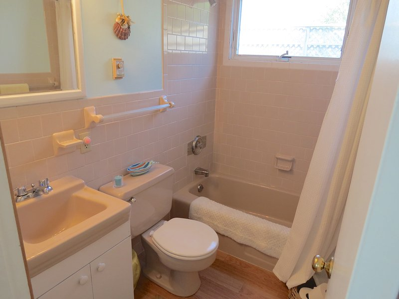 Main level full bath has combination tub and shower.