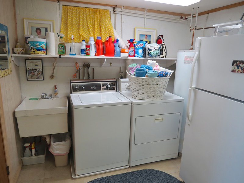 Lower level laundry and spare fridge.