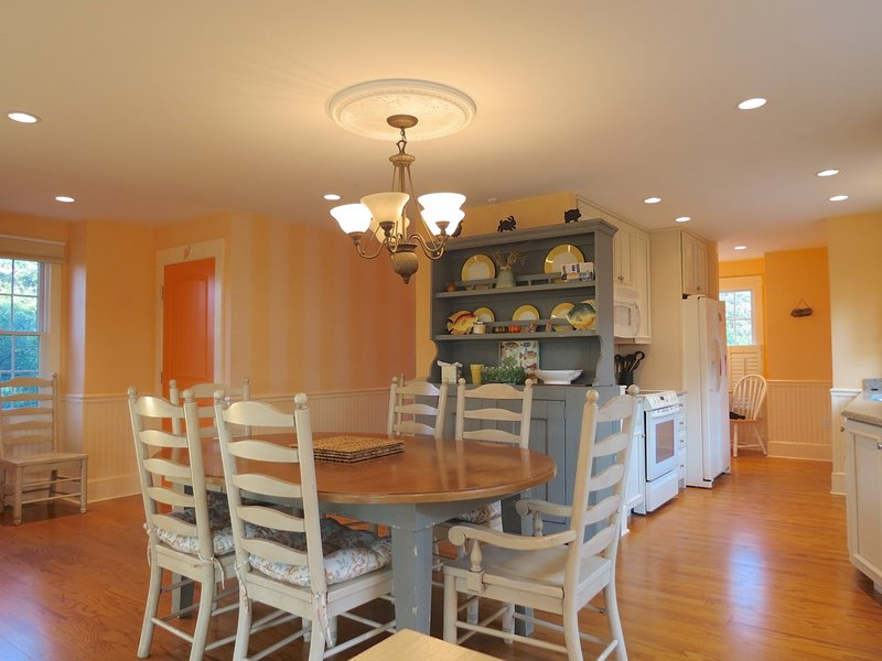 You walk from the kitchen into the dining area . . .