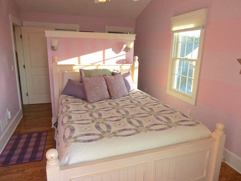 Upper level bedrooms include the master with a queen. . .