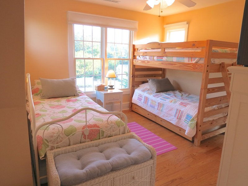 Other upper level bedrooms include this one with bunks and a day bed.