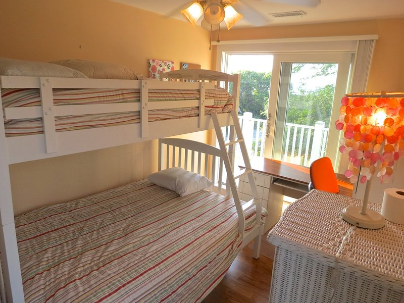 And this one with a full size double under and regular bunk bed over. Note the sliders out to the upper level deck with nice water views.