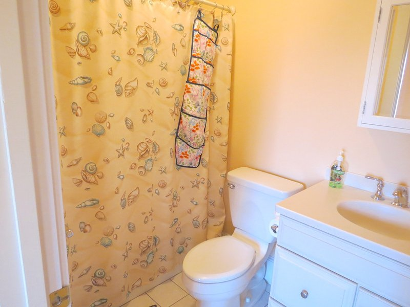 Those last two bedrooms share this full bath.