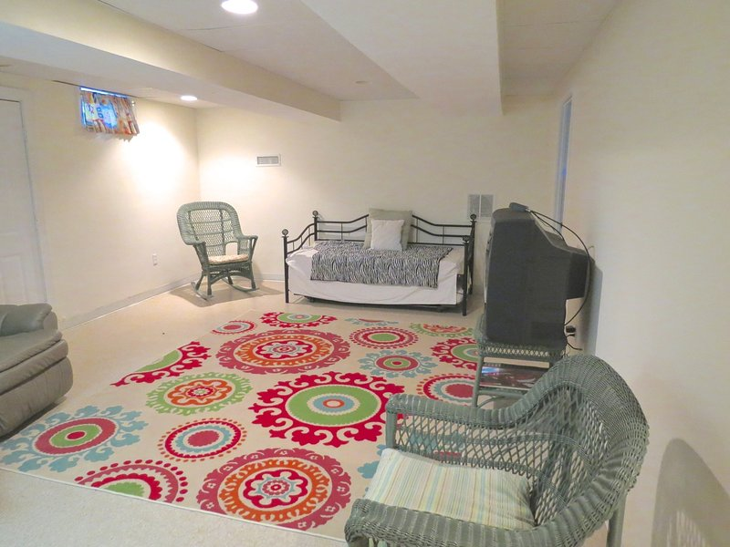 Lower level has a day bed with trundle and doubles as another TV lounge area.