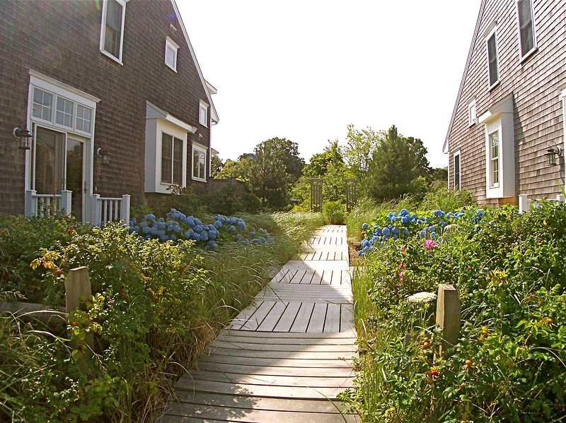 Walkway separates the property from its look-alike neighbor.