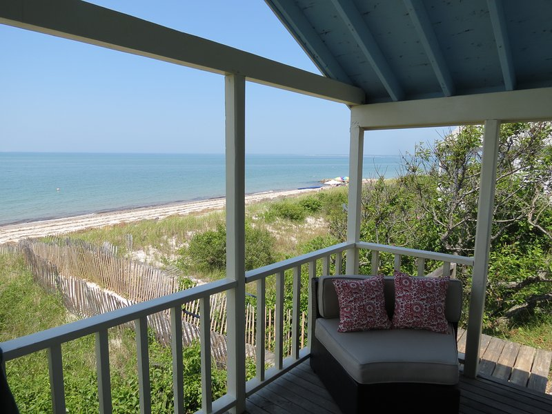 . . and here, looking east.  the beach steps, are just off the porch at the rear of this shot.  Your feet are in the sand in seconds.Thanks to the covered porch, you're on the beach -- but out of the sun.