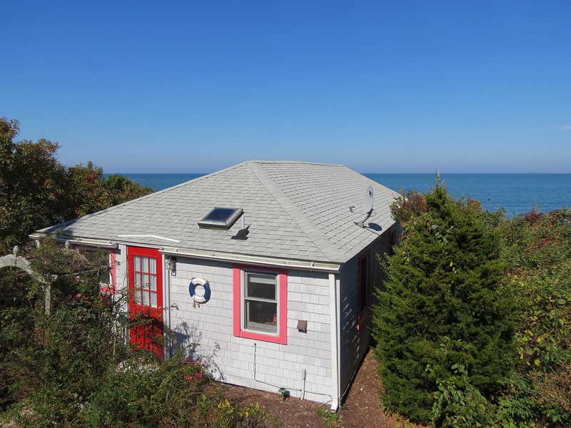 Here's your classic Cape beach cottage, directly on a perfect sandy Brewster beach.
