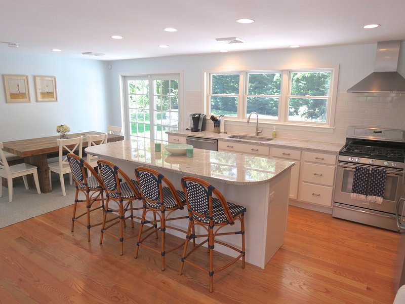 The custom gourmet kitchen is ideally equipped.