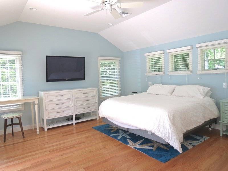 The master bedroom features a King Bed and vaulted ceilings
