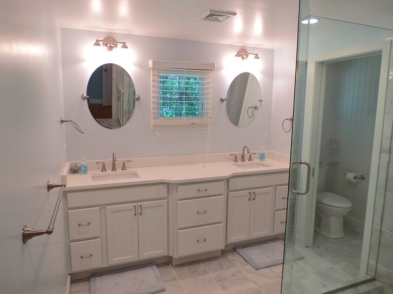 The master bathroom is spectacular with a dual sink custom vanity